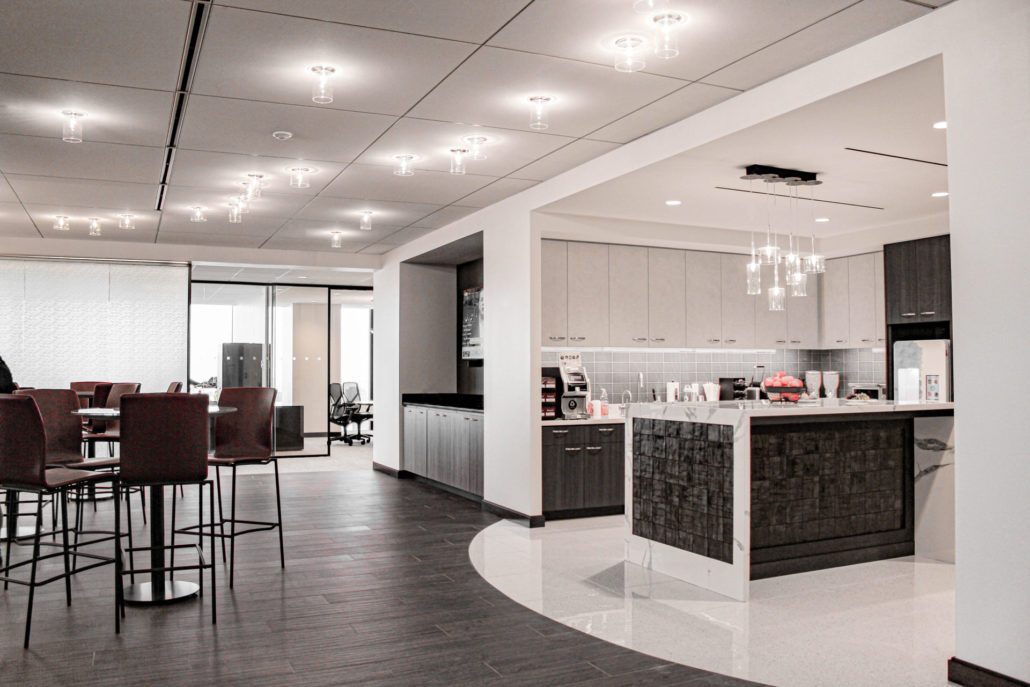center island and bright white finishes invites employees to congregate in the cafe and lounge.