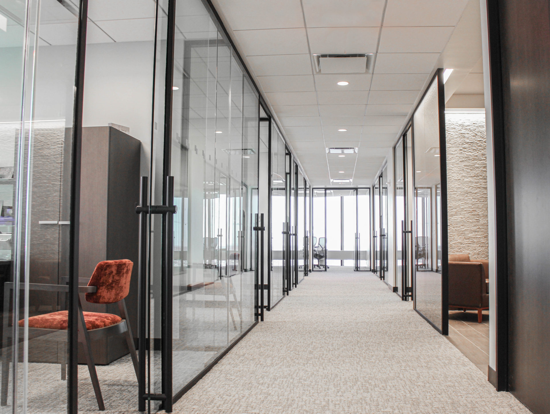 glass front offices create light and bright hallways that are flooded with natural light.